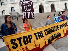 Tribal and environmental groups opposed to the proposed Enbridge Line 3 project rally Thursday, Sept. 28, 2017 at the State Capitol in St. Paul, Minn.