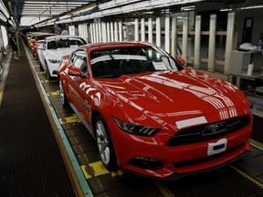 Ford Motor Co. Mustangs move along the production line at the company's Flat Rock Assembly Plant in Flat Rock, Michigan.