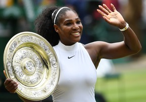 Serena Williams poses with the winner's trophy at the 2016 Wimbledon Championships