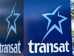 An Air Transat sign is seen in Montreal on May 31, 2016. Air Transat has signed a deal with AerCap for the long-term lease of seven new Airbus aircraft. Financial terms of the deal were not immediately disclosed.