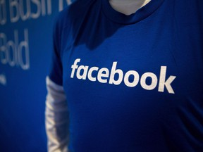 Guest are welcomed by people in Facebook shirts as they arrive at the Facebook Canadian Summit in Toronto on March 28, 2018. Facebook Canada will launch a fact-checking program to deem stories as false and provide social media users with more context on stories they read on the platform.