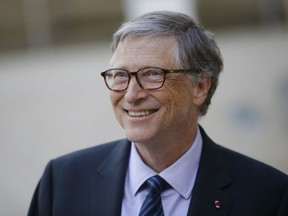 FILE - In this April 16, 2018, file photo, Bill Gates, Co-Chair of the Bill & Melinda Gates Foundation, talks to the media after a meeting with French President Emmanuel Macron at the Elysee Palace in Paris. The Seattle region is home to the two richest men in America, but while Amazon's Jeff Bezos is blamed by some for rising rents and clogged city streets, Gates is largely admired for helping lead the computing revolution and for the billions he donates through his philanthropy.