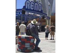 Visitors to the BBQ, Brews and Blues festival listen to a band in downtown Reno on June 16, 2018. The number of tourists visiting Reno-Sparks and Washoe County over the past year topped the 5 million mark for the first time since 2007.