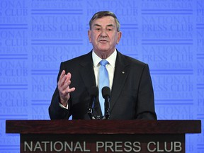 Huawei Technologies Australia Chairman John Lord speaks at the National Press Club in Canberra, Wednesday, June 27, 2018. Lord says Australia could damage its economic future if it bans the Chinese telecommunication giant from the nation's next-generation mobile network technology.