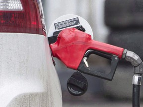 A gas pump is shown at a filling station in Montreal. An online price monitoring firm says gasoline prices in Canada have spiked at the highest average price ever recorded thanks mainly to a 17-cent increase in the price per litre of regular fuel in Calgary.