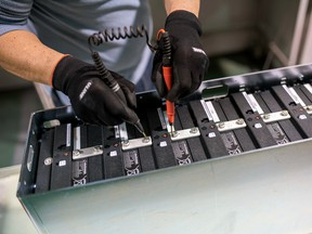 Lithium-ion batteries are used in electric vehicles, but last year was a tough one for lithium producers; one Canadian company hopes to make it through the rough patch with a new mine.