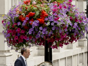Britain's new Secretary of State for Exiting the European Union Dominic Raab leaves 10 Downing Street after it was announced he was appointed to the job in London, Monday, July 9, 2018. Former Housing Minister Dominic Raab is to take up the post, after U.K. Brexit Secretary David Davis resigned from the Cabinet and said Monday that he won't seek to challenge Prime Minister Theresa May's leadership.