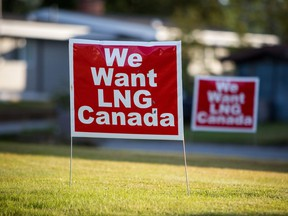 "Signs reading ""We Want LNG Canada"" stand on a lawn in the residential area of Kitimat, British Columbia."