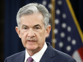 FILE- In this June 13, 2018, file photo, Federal Reserve Chair Jerome Powell speaks to the media after the Federal Open Market Committee meeting in Washington. The Federal Reserve says it expects low unemployment and rising inflation will keep it on track to raise interest rates at a gradual pace over the next two years. By late 2019, the Fed says its key policy rate should be at a level that will be slightly restrictive for growth.