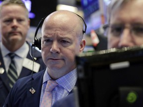 Trader Patrick Casey, center, works on the floor of the New York Stock Exchange, Thursday, July 12, 2018. Stocks are opening higher as technology companies rally.