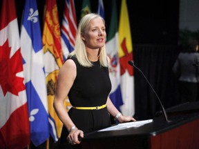 Canada will review the joint vehicle emissions standards it has with the United States before it decides what to do about the U.S.'s plan to weaken those standards in the coming years. Minister of Environment and Climate Change Catherine McKenna speaks at a press conference in Ottawa on June 28, 2018.