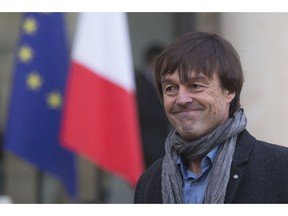 FILE - In this Thursday, Dec. 6, 2012 file photo, environmental activist Nicolas Hulot, smiles as he leaves the Elysee Palace in Paris, France. France's high-profile environment minister, former TV personality Nicolas Hulot, has unexpectedly announced his resignation live on national radio, dealing a blow to the lofty green ambitions of President Emmanuel Macron.