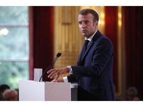 French President Emmanuel Macron delivers a speech during the annual French ambassadors' conference at the Elysee Palace in Paris, France, Monday, Aug. 27, 2018.