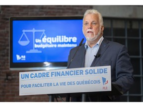 Liberal leader Philippe Couillard presents his party's financial platform in Montreal, on Wednesday, September 12, 2018.