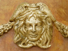 The Versace logo on one of the vases at the entrance of a mansion once owned by Italian designer Gianni Versace in Miami Beach, Fla. Michael Kors is buying the Italian fashion house Gianni Versace in a deal worth more than US$2 billion.