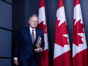 Governor Stephen Poloz heads in to explain his announced rate hike Wednesday.