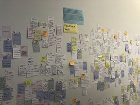 """In this Aug. 15, 2018 photo, post-it notes cover a wall labeled """"feedback"""" during a forum hosted by Google affiliate Sidewalk Labs in Toronto, Canada, regarding a proposal to take a rundown neighborhood of Toronto's waterfront and develop it into perhaps the most wired community in history. Critics of the project have raised alarms about whether the idea gives the tech giant too much data and power."""