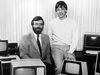 Microsoft Corp. co-founders Paul Allen, and Bill Gates pose with International Business Machines personal computers after signing a software contract with IBM in Oct. 1981.