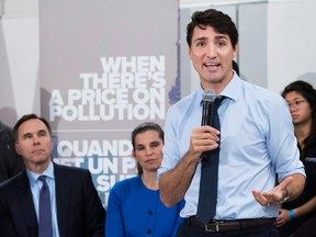 Prime Minister Justin Trudeau speaks to the media and students at Humber College regarding his government's new federally imposed carbon tax in Toronto on Tuesday, October 23, 2018.