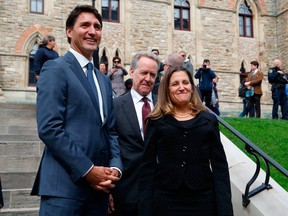 Prime Minister Justin Trudeau, left, Canada's chief trade negotiator Steve Verheul, centre, and Minister of Foreign Affairs Chrystia Freeland, right, walk to a press conference to announce the new USMCA trade pact between Canada, the United States, and Mexico in Ottawa, October 1, 2018.