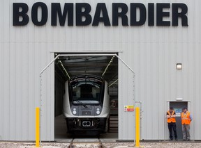 An Aventra Class 345 electric multiple-unit test train, manufactured by Bombarider Inc., sits on tracks in a hangar at the Bombardier Transportation UK Ltd. Rail Vehicles Production Site in Derby, U.K.