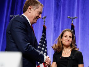 U.S. Trade Representative Robert Lighthizer and Canadian Foreign Affairs Minister Chrystia Freeland shake hands during the NAFTA negotiations.