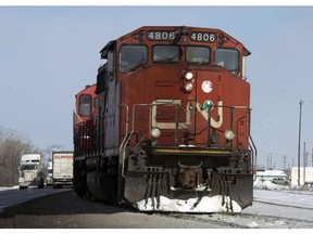 A Canadian National locomotive is shown in Montreal on February 23, 2015. Canadian National Railway Co. is laying off some non-unionized workers, barely two weeks after the company reported the highest quarterly revenues in its 99-year history.THE CANADIAN PRESS/Ryan Remiorz