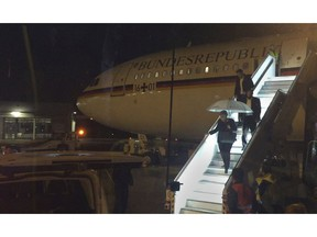 In this Nov. 29, 2018 photo German chancellor Angela Merkel leaves the government Airbus which was grounded after a technical failure at the airport in Cologne, western Germany, delaying Merkel's arrival at the G20 summit in Buenos Aires.