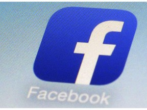 """FILE - This Feb. 19, 2014, file photo, shows a Facebook app icon on a smartphone in New York. Facebook is admitting that it didn't do enough to prevent its platform from being used to incite violence and spread hate in Myanmar. A Facebook executive said in a blog post late Monday, Nov. 5, 2018, that the company """"can and should do more."""""""