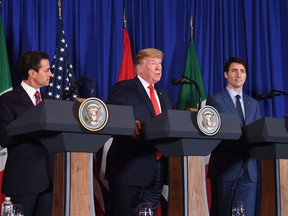 Mexican President Enrique Pena Nieto, US President Donald Trump and Canadian Prime Minister Justin Trudeau deliver a statement on the signing of a new free trade agreement in Buenos Aires, on November 30, 2018, on the sidelines of the G20 Leaders' Summit.