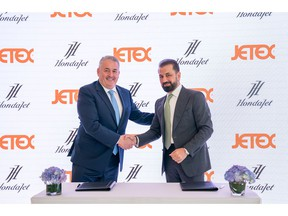 Adel Mardini of Jetex signs with Simon Roads of Honda Aircraft Company