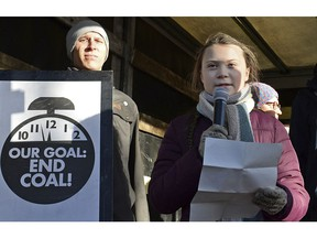 Swedish young activist, 15-year-old Greta Thunberg, right, speaks to climate activists during the March for Climate in a protest against global warming in Katowice, Poland, Saturday, Dec. 8, 2018, as the COP24 UN Climate Change Conference takes place in the city.