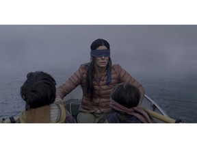 """FILE- This file image released by Netflix shows Sandra Bullock in a scene from the film, """"Bird Box."""" Netflix lifted the usually tightly sealed lid on its viewership numbers in a recent tweet that disclosed 45 million subscriber accounts had watched the thriller, """"Bird Box,"""" during its first seven days on the service. That made the film the biggest first-week success of any movie made so far for Netflix's 12-year-old streaming service."""