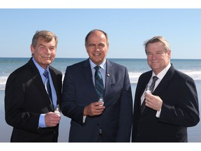 Rob Koeneman, co-founder, President and Senior VP Technology at Joi Scientific, left to right, Gaetan Thomas, CEO, NB Power and Traver Kennedy, CEO, Joi Scientific are seen in this undated handout photo. New Brunswick's Crown-owned power utility is partnering with a Florida-based company to develop power plants that would use hydrogen extracted from seawater as their fuel. NB Power signed a license agreement with Joi Scientific three years ago, but have now agreed to work together to build a number of prototypes that would eventually be used in the province.