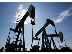 Pumpjacks are shown pumping crude oil near Halkirk, Alta., on June 20, 2007. Drilling companies are continuing to move rigs from Western Canada into the more active oilfields of the southern United States.