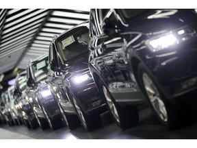 FILE - In this March 8, 2018 file photo photo Volkswagen cars are pictured during a final quality control at the Volkswagen plant in Wolfsburg, Germany. Germany's economic growth has stagnated in the last three months of the year.