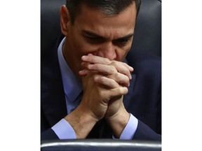 FILE - In this Wednesday, Feb. 13, 2019 file photo, Spain's Prime Minister Pedro Sanchez at the Spanish parliament in Madrid. Sanchez is under pressure to call an early election with an announcement expected Friday Feb. 15, 2019, putting Spain on the path to its third general election in less than four years.
