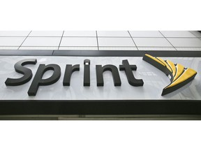 FILE - This April 30, 2018, file photo shows signage for a Sprint store in New York's Herald Square. The top executives of T-Mobile and Sprint are making the case to Congress that their proposed $26.5 billion merger wouldn't hurt competition and jack up the prices consumers pay for wireless service.