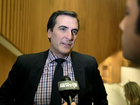 """FILE- In this Jan. 19, 2015 file photo, Sen. Deputy Majority Leader, Michael Gianaris, D-Astoria, speaks with reporters after listening to New York Gov.  Gov. Andrew Cuomo warns that what he calls """"political pandering"""" to critics of Amazon's proposed secondary headquarters could sink New York's biggest-ever economic development deal. But opponents say they'll keep fighting a project they see as corporate welfare. Friday's back-and-forth came after The Washington Post reported that Amazon is reconsidering its planned New York City headquarters because of opposition from local politicians."""