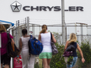 Workers arrive for their shift at the Chrysler (FCA) assembly Plant in Windsor, Ont., on June 12, 2018.