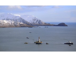 An oil and gas industry representative says Canada is falling behind the U.S. and other Arctic nations in developing its rich natural resources because of a five-year moratorium on offshore drilling until at least 2021. The floating drill rig Kulluk in Kodiak Island, Alaska's Kiliuda Bay as salvage teams conduct an in-depth assessment of its seaworthiness on Jan. 7, 2013.