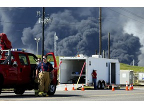 Firefighters arrive at the site where the Intercontinental Terminals Company petrochemical fire reignited, Friday, March 22, 2019, in Deer Park, Texas.  The efforts to clean up a Texas industrial plant that burned for several days this week were hamstrung Friday by a briefly reignited fire and a breach that led to chemicals spilling into the nearby Houston Ship Channel.