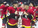 algary Inferno's Zoe Hickel (left) and Tori Hickel celebrate with the trophy after beating Les Canadiennes de Montreal 5-2 to win the 2019 Clarkson Cup game in Toronto, on Sunday, March 24 , 2019.