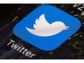 FILE - This April 26, 2017 file photo shows the Twitter app icon on a mobile phone in Philadelphia. Twitter said Thursday April 4, 2019, it has stopped blocking French government ads calling on people to vote after it came under fire from authorities for being overzealous in applying a law aimed at banning fake news.