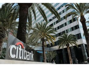 FILE- This March 23, 2018, file photo shows the entrance to Citibank at the Citigroup Center in downtown Los Angeles. Citigroup reports earnings Monday, April 15, 2019.