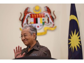 Malaysian Prime Minister Mahathir Mohamad gestures during a press conference in Putrajaya, Malaysia, Monday, April 15, 2019. Malaysia's government decided to resume a China-backed rail link project, after the Chinese contractor agreed to cut the construction cost by one-third.