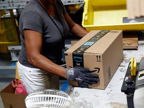 A worker packs an Amazon order at a fulfillment centre in Baltimore, Maryland.