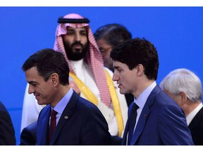 Crown Prince of Saudi Arabia Mohammed Bin Salman, top, looks towards Prime Minister Justin Trudeau, bottom right, as they arrive to take part in a family photo at the G20 Summit in Buenos Aires, Argentina on November 30, 2018. At least one Canadian-based company is optimistic about its prospects in Saudi Arabia, a bullishness that comes as businesses fret about their future in the kingdom following a diplomatic fallout with Ottawa.