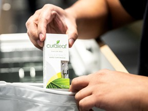 An employee puts a vape cartridge in a bag at a Curaleaf Inc. store in New York.