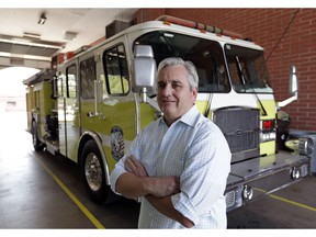 In this Tuesday, May 28, 2019 photo, Timothy Stromsnes, president of the Reedy Creek Professional Firefighters Local 2117, stands next to one of the trucks at Station 2 at Walt Disney World in Lake Buena Vista, Fla. Firefighters for Walt Disney World's private government say they're vastly understaffed, posing a safety risk as the 25,000-acre Florida theme park resort grows even bigger this year with the debuts of a new Star Wars land, a new air-gondola system and even more hotel rooms.